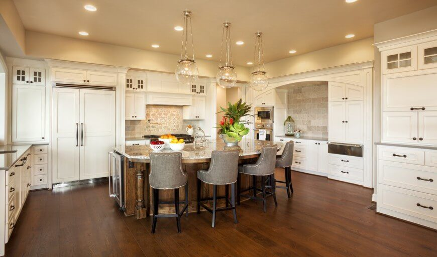 dream kitchen designs. Delicate orb pendant lights hang above the island in this rich kitchen  The stained wood 30 Custom Luxury Kitchen Designs that Cost More than 100 000