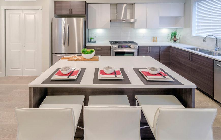 ultra modern minimalism informs this sleek kitchen pairing white countertops tile backsplash and