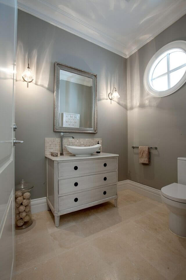 Bathroom with Round Ship-Style Window with White Frame