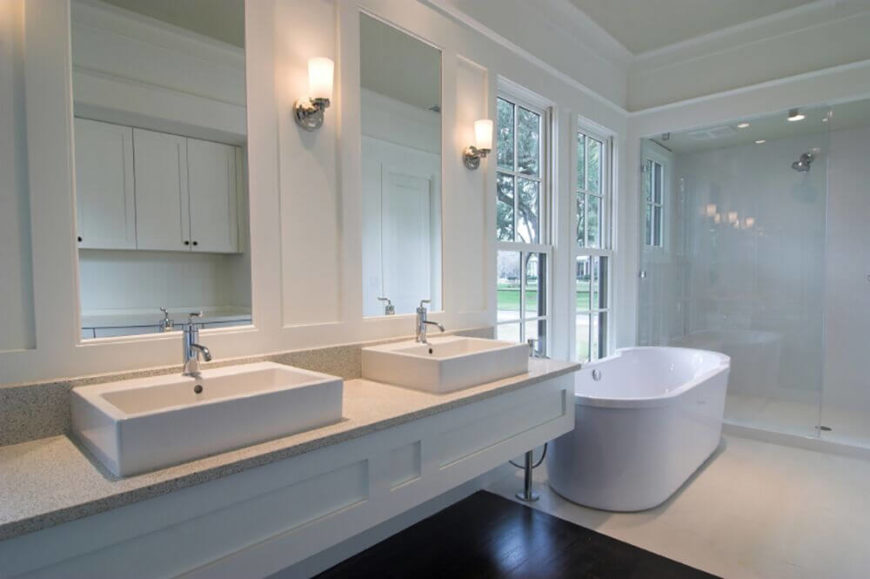 Pair of Tall Thin Windows Next to Freestanding Bathtub
