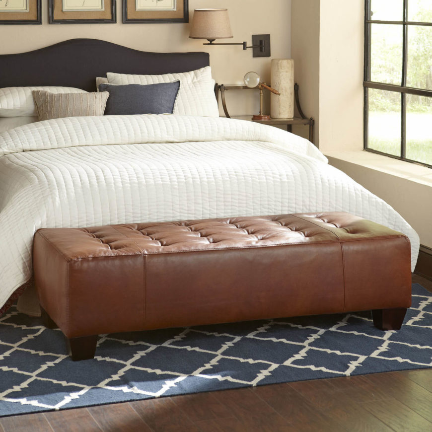 the wood frame of this classic button tufted rectangular ottoman is covered in a cushy