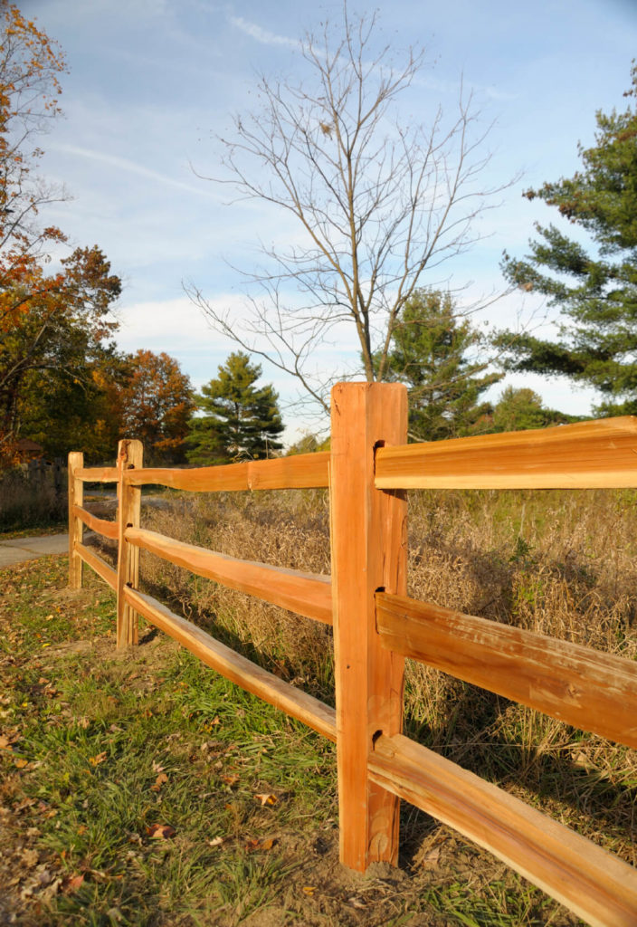Another mortised fence in the standard red-orange cedar. Cedar is a beautiful option, as it turns silver as it ages. Split rail fences are, on average, more attractive than other types of wood fencing as they age.
