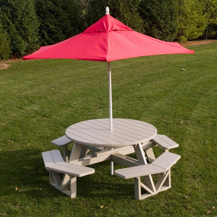 Here Is A Nice Wound Plastic Picnic Table With An Umbrella. This Higher End  Picnic