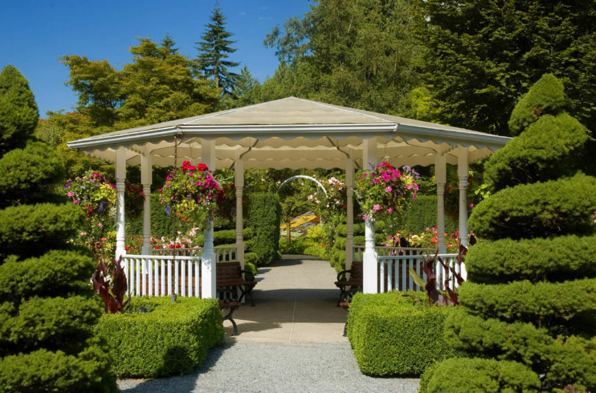 This gazebo is surrounded by all variety of hedges and shrubs. This is the perfect gazebo for enjoying the result of the hard work that has gone into the garden.