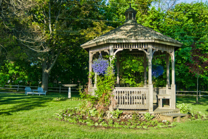Allowing vines to crawl up the pillars and walls of your gazebo is a great way to build depth and introduce life into your structure.