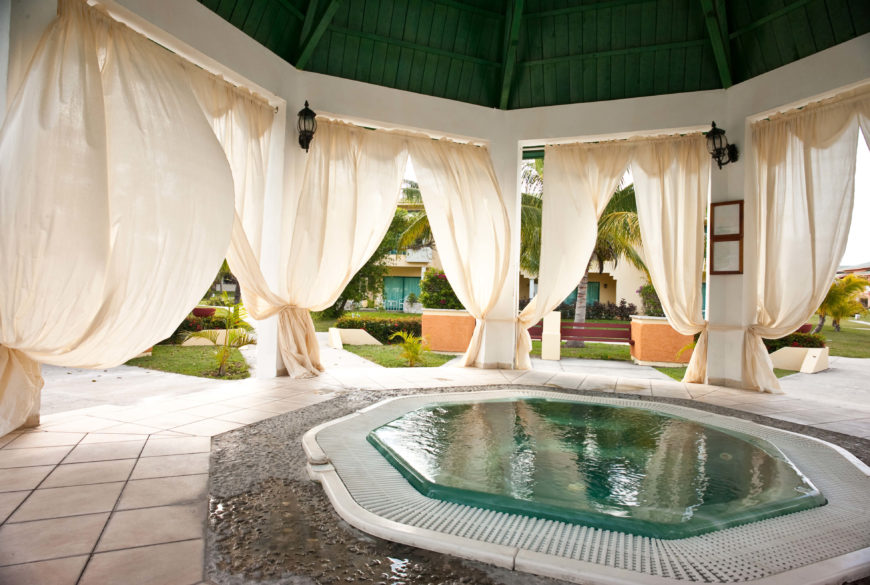 this large space is an elegant and gazebo with a private hot tub right in