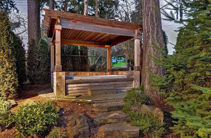 This natural wood gazebo and hot tub build a superbly rustic and natural feel within this wooded space. You can even add a modern touch with a television so you can catch your shows while you relax.
