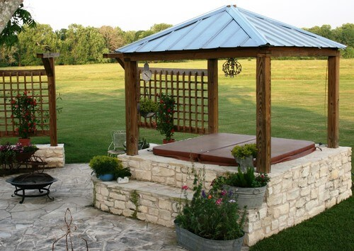 This gazebo is just spacious enough to house this hot tub. It is the perfect cover of shade on hot days and protects against the rain and snow on such occasions.