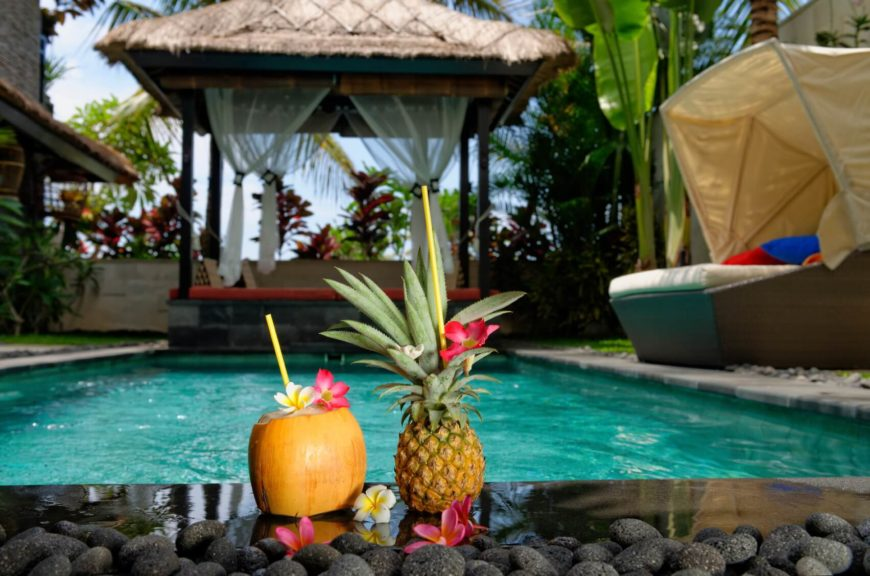 This gazebo is furnished with bedding to create a laid back and comfortable place to relax and have some island themed drinks. Let yourself feel the tropical influence in this island getaway.