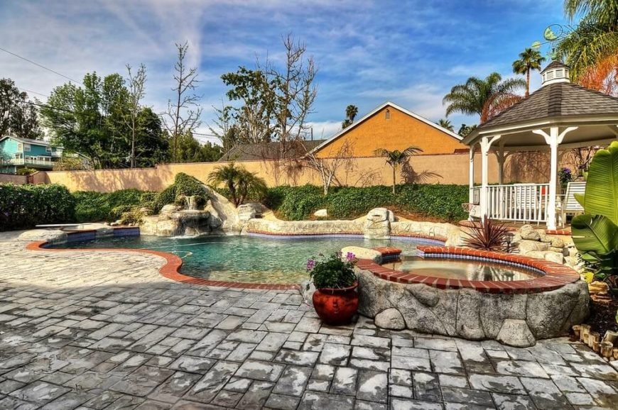 This relaxing gazebo is a great spot to kick back and watch over the swimmers and enjoy the rest of the landscaping.