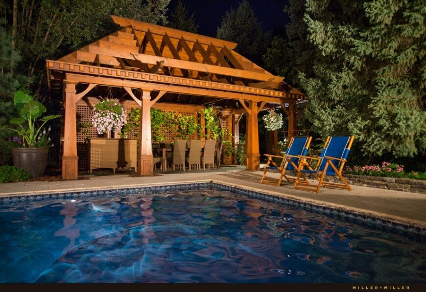 This gazebo houses a long table that can seat a large number of people. Your party or get together will be perfectly hosted here in this wonderful poolside area.