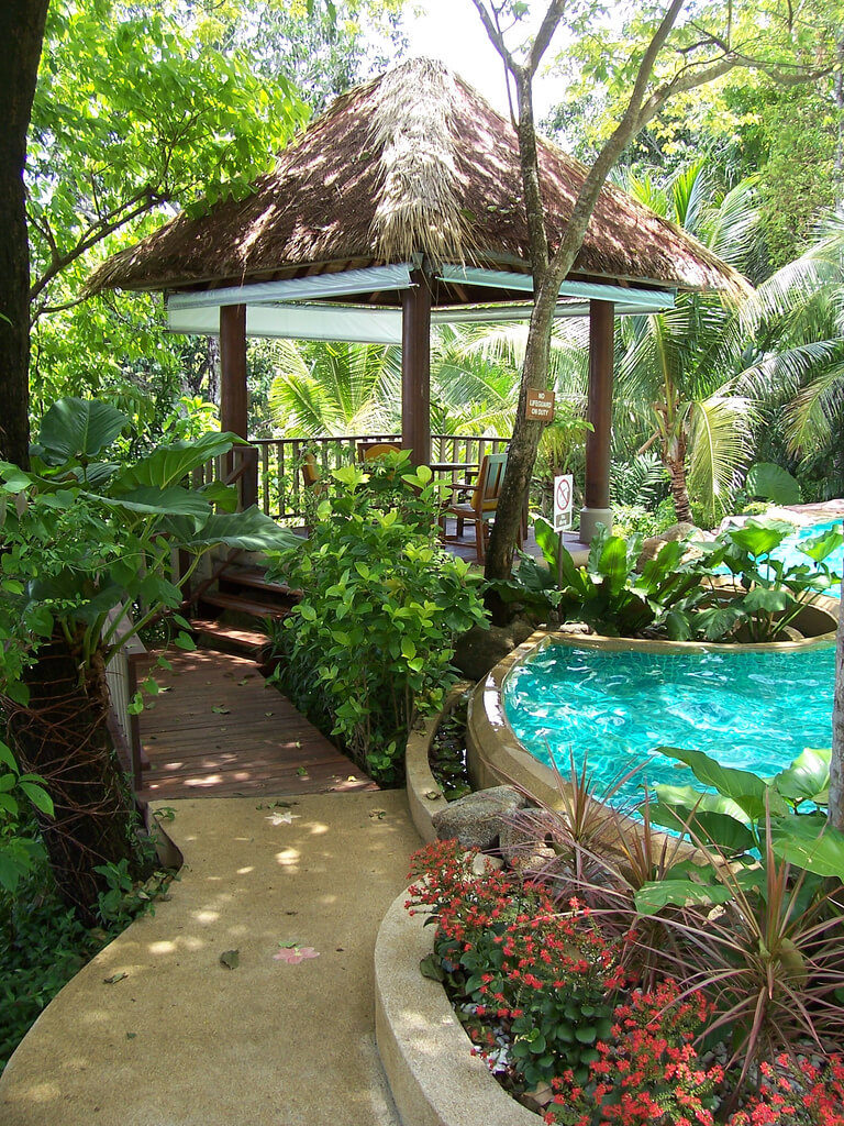 This island based gazebo introduces a tropical feel to the pool, creating your own oceanside getaway.