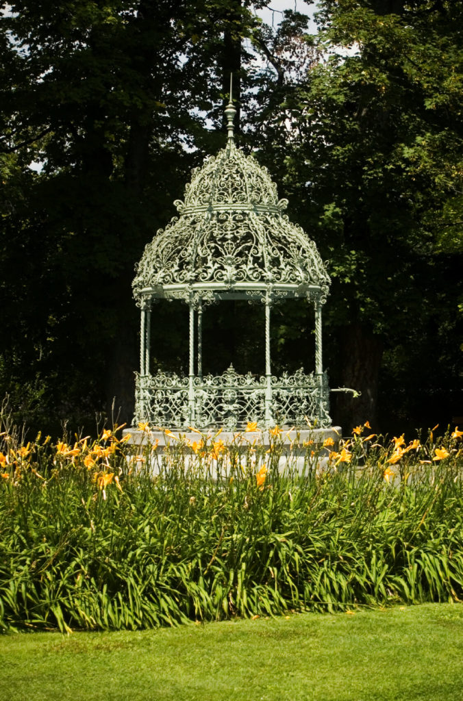 Here is a wonderful decorative gazebo that is perfect for climbing plants and other flowers. The surrounding garden is the perfect pair for this gazebo.