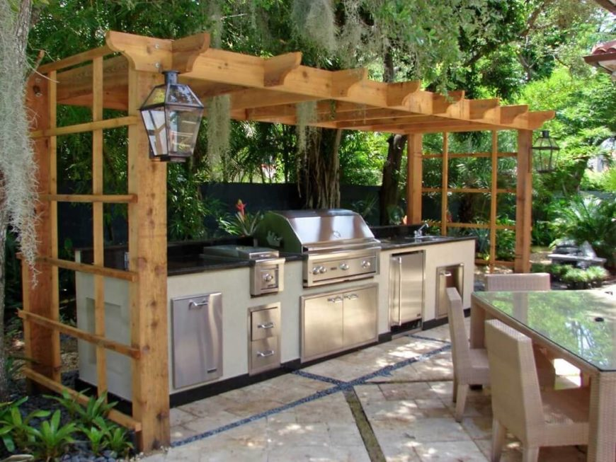 this pergola style gazebo rests over the top of this stainless steel grill and outdoor kitchen area the area is just below large willow trees - Bbq Grill Design Ideas