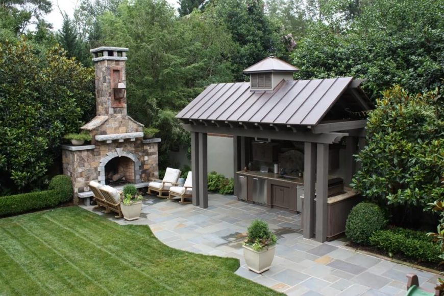 This wood and vinyl gazebo is the perfect size to house the chefs while guests relax nearby next to the fireplace.