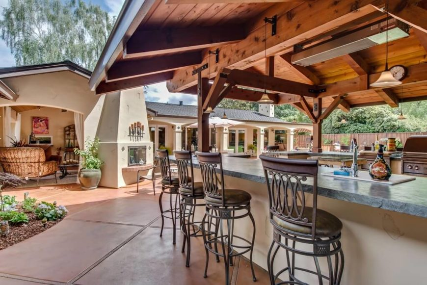 This outdoor grilling area is tucked into the inside of this gazebo ...