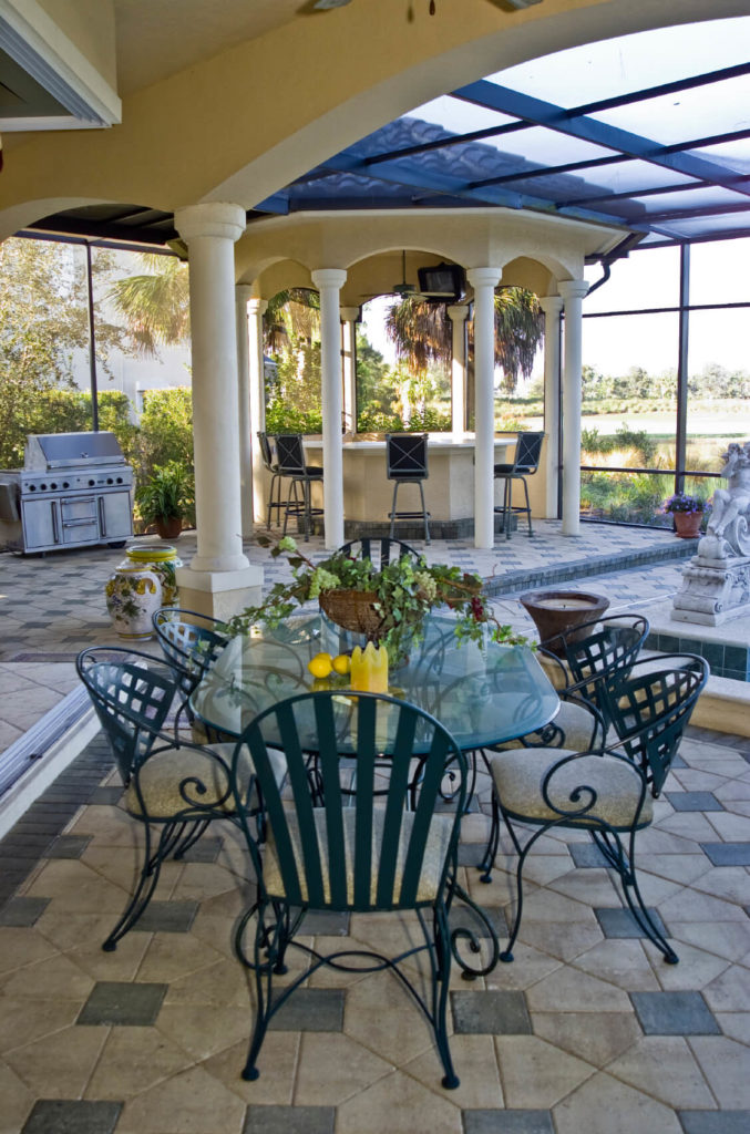 This is a great example of a gazebo within a sunroom. The outdoor entertaining space is entirely encased in class, with an interior gazebo with both a grill and a large eating area.