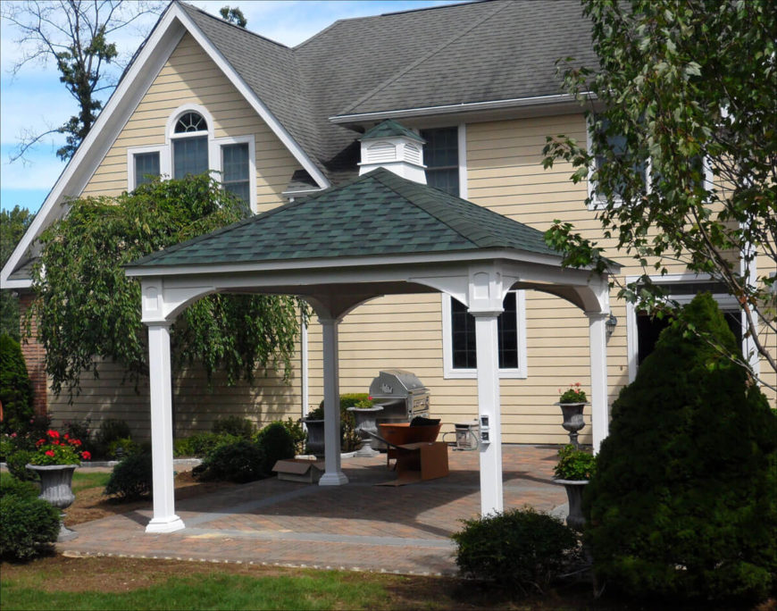 This is a simple gazebo that is large enough to house both a grill and a small dining area.