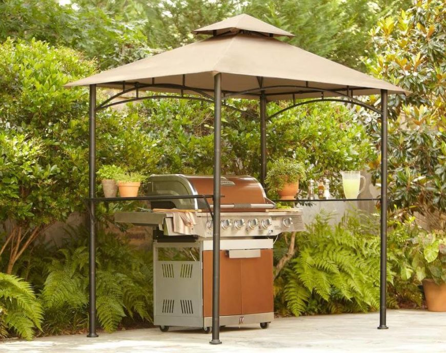 Shelves on either side of this aluminum and canvas grill gazebo ensure that there's plenty of space to set drinks, plates, and preparation materials.