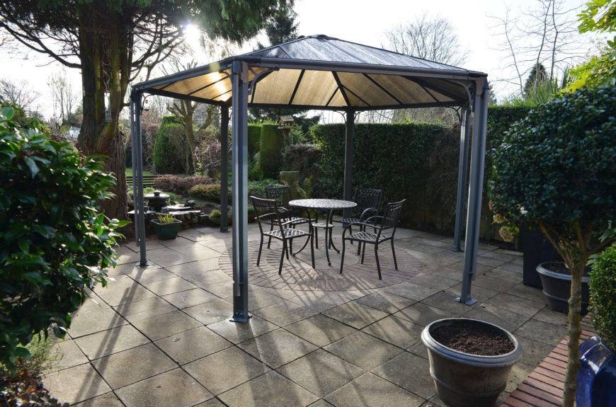 If you want a touch of sun coming through but still desire shade, gazebos with tinted tops like this are a wonderful solution. They block out most of the sun but also let some light through so you won't be completely in the dark.