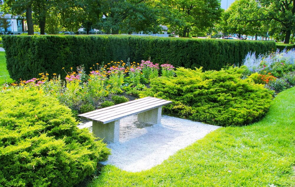 This kind of concrete sleepers bench is commonly found in public parks, but it looks just as good incorporated into a garden.