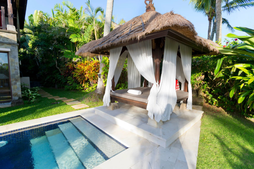 This tropical themed gazebo sits poolside and serves as a laid back relaxation spot. Even though the shape is square, the roof can still have interesting and appealing design.