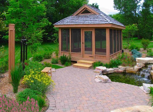 Here is a pond side gazebo with installed screen walls and a door. It is a way to make sure that the structure keeps out as many insects as possible since the screens can sometimes let some in.