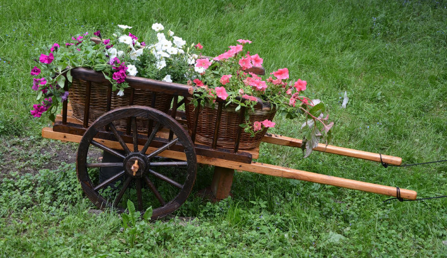 27 Wheelbarrow Flower Planter Ideas For Your Yard
