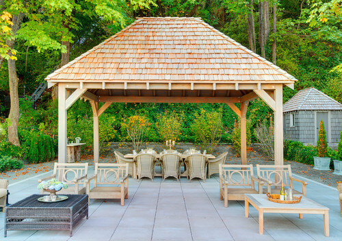 This tall and sturdy gazebo provides a wonderfully elegant and high-end space to hold your outdoor meals. You will be dining in style on this serene patio.