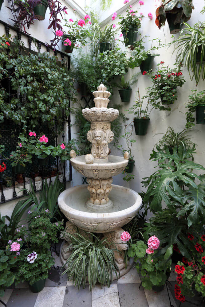 Great use of a patio corner with a myriad of potted flowers  a small  fountain. 35 Patio Potted Plant and Flower Ideas  Creative and Lovely Photos