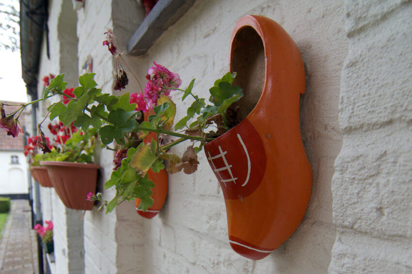 whitewashed walls are good backdrops for wall mounted clay flower pots you can also add