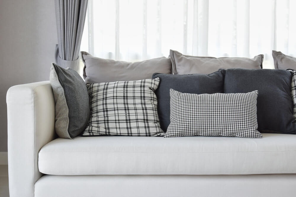 one canu0027t help but love the white sofa with black grey and white