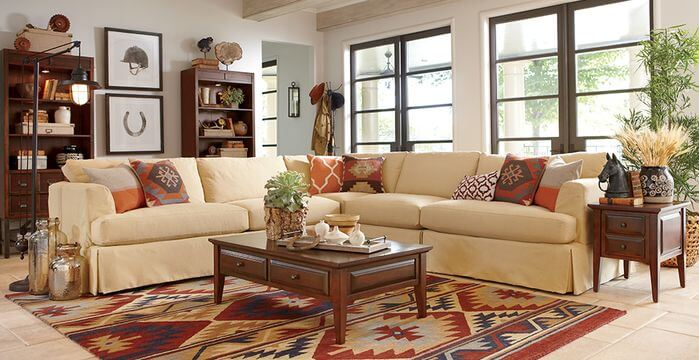 tan sectional sofa with patterned earth tone throw pillows - Decorative Pillows For Sofa