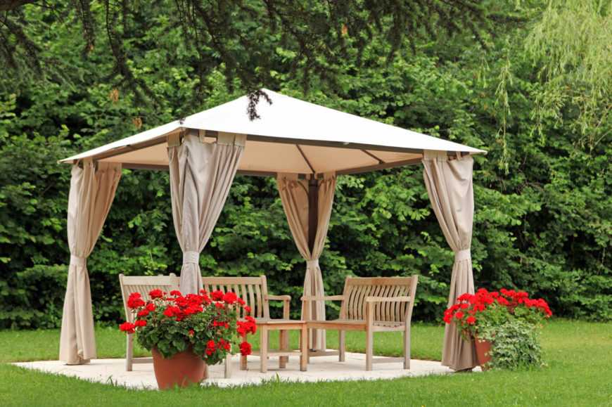 The vaulted roof keeps the interior of this gazebo feeling open and airy, even when the curtains are closed.