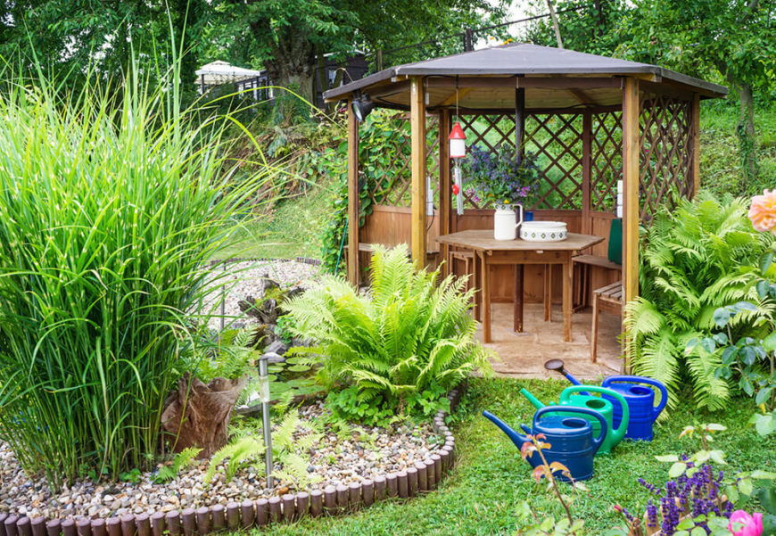 Here is a small gazebo that houses a beautiful cafe style table and a couple of chairs. This would be a lovely place for breakfast or lunch on a nice Saturday morning.