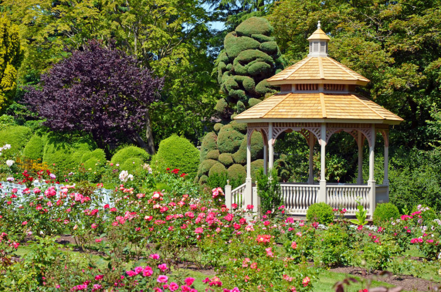 A white gazebo in a garden is a classic image that brings up thoughts of elegance and sophistication. With a pretty gazebo like this, you can relax in the shade while looking out over your garden that you worked so hard on.
