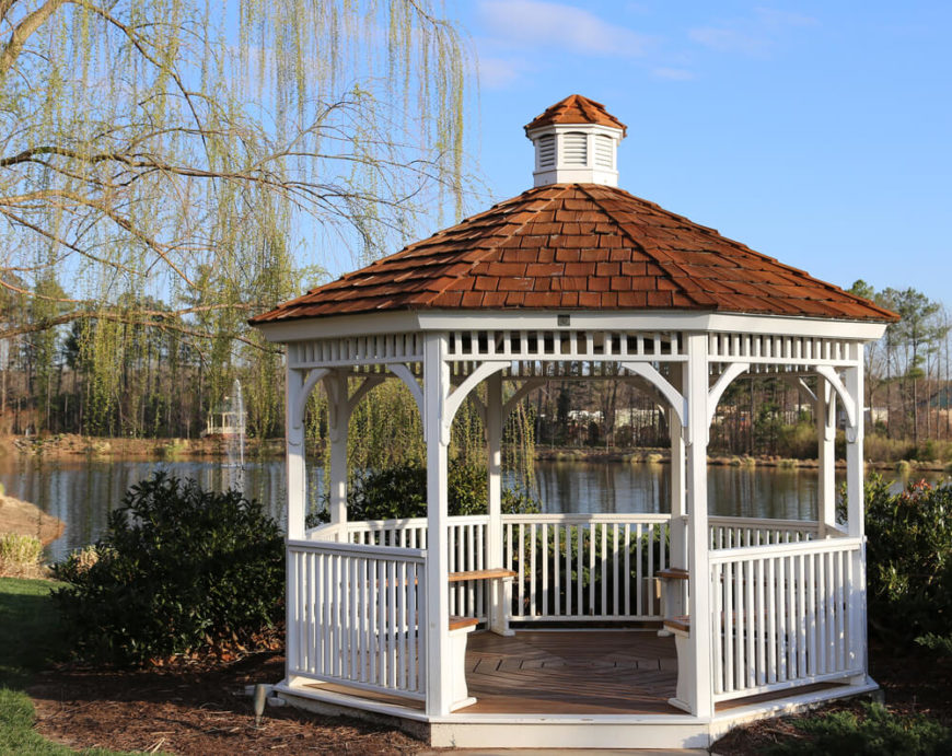 This lakeside gazebo is equipped with benches. The seats give this space a welcoming feel that will be hard to resist for those walking by. The gazebo calls to you to enter and take a load off.