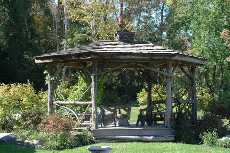 Not every gazebo is made from well cut and finished wood. This gazebo shows that you can have a lovely and stylish gazebo from raw and unfinished wood as well. It looks as if this gazebo has trees as pillars that grew here to hold up the roof.