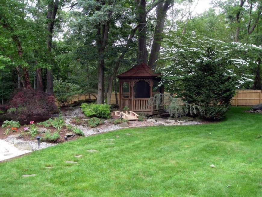 This gazebo acts as a passage from the manicured lawn to the woods behind it. Gazebos can work as great passageways to transition between two different spaces.