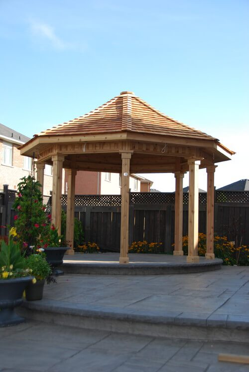 This uncomplicated wooden gazebo area is the perfect addition to a patio. It provides extra shade while introducing design qualities and a central focus to the space.