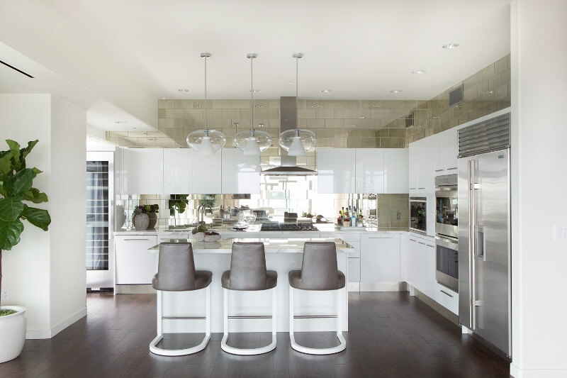 Contemporary White Kitchen with Mirrored Tile Backsplash