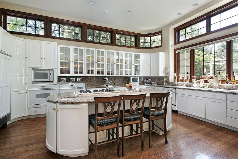 Classic Craftsman White Kitchen with Curved Cabinetry