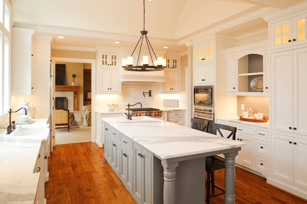 Contemporary White Kitchen with Gray Island