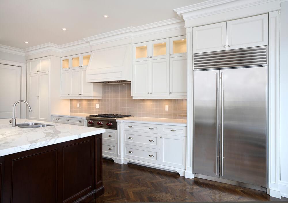Classic White Kitchen with Herringbone Floors