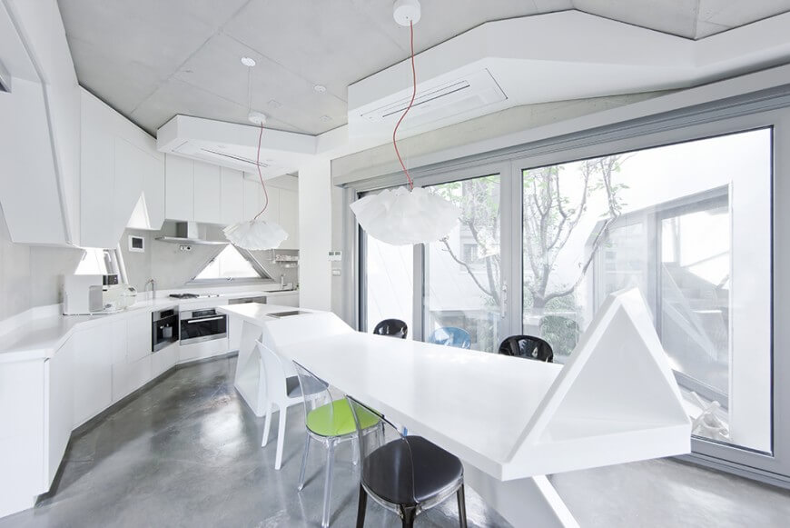 Unique Kitchen with Angles and Stark Pops of Color