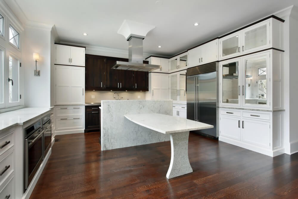 White Kitchen with Incredible Granite Slab Table