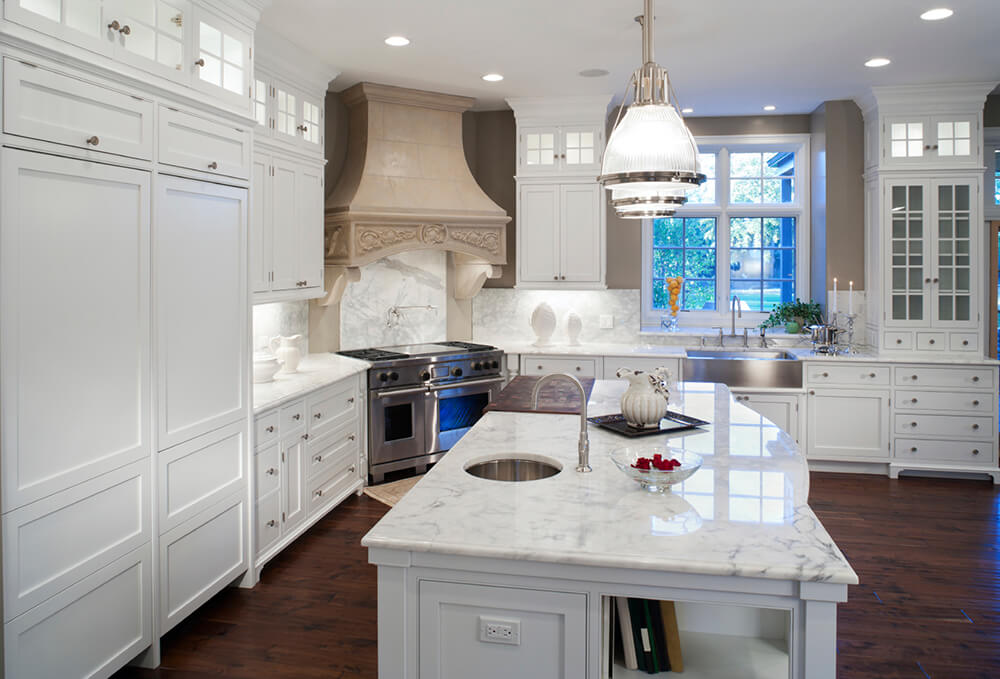 Elegant White Kitchen with Contrasting Vent Hood