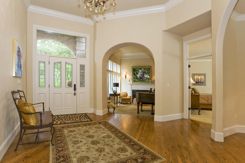Spacious foyer with multiple entry points to the home