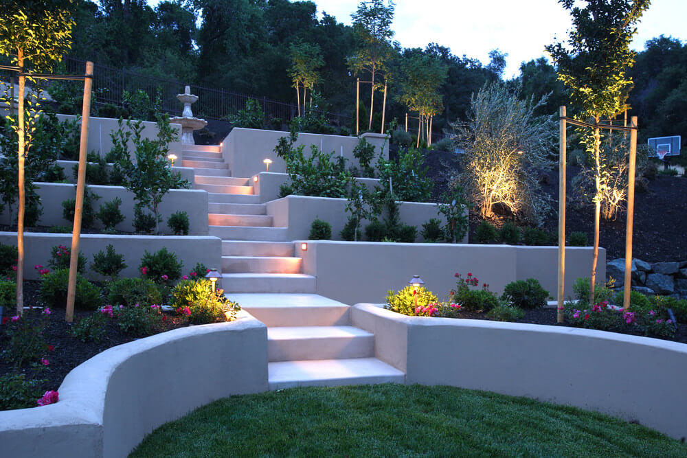 gorgeous steps and gardens in a backyard amazing lighting