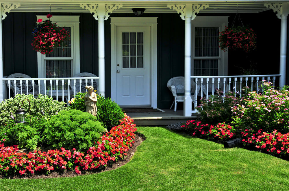 the garden of healthy grasses and shrubs house a welcoming woman figure resting behind the bush